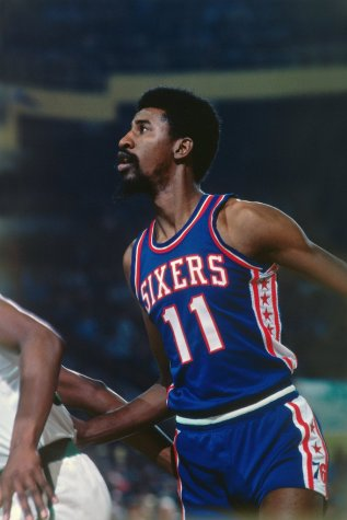 Caldwell Jones looks on during a 76ers game played in 1977.